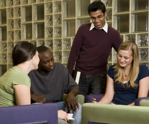 Four young adults studying together