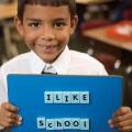 Boy_holding_up_I_Like_School.jpg